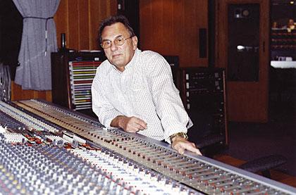 Al Schmitt sits at his console