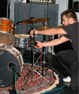 JD Keiser sets up drum mics